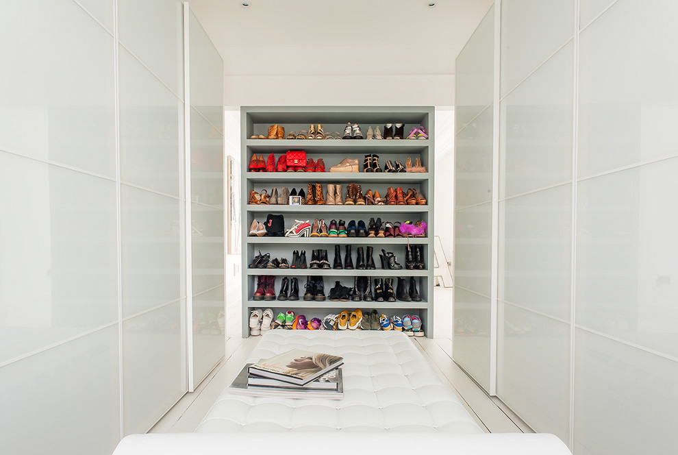 In order to make your walk-in space looks minimalist, you could conceal the wardrobe contents behind sliding doors. Leaving something on open shelves would become a focal point of such closet.