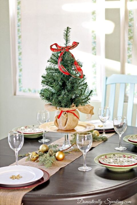 A baby version of your large Christmas tree is the perfect size for a table — instead of a star, try a bow. See more at Domestically Speaking » What you'll need:mini tree ($9,amazon.com),plaid ribbon($12,amazon.com)