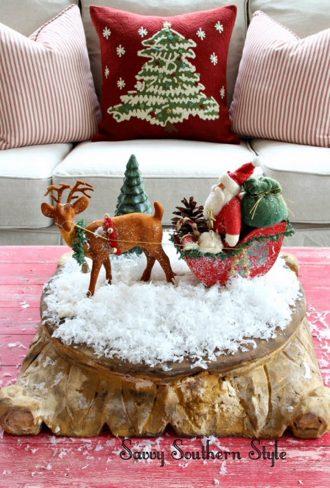 A miniature display of Santa Claus and his reindeer looks especially fun on some fake snow. See more at Savvy Southern Style » What you'll need: vintage figurine (ebay.com), fake snow ($9, amazon.com)