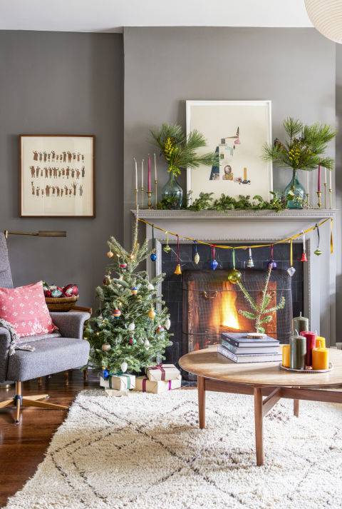 Bigger isn't always better. A tiny tree brings plenty of cheer, and it's easier for kids to decorate. Just maybe put the more fragile ornaments somewhere else ... What you'll need: wooden ornaments ($16, amazon.com), brass candlesticks ($74 for 2, food52.com)