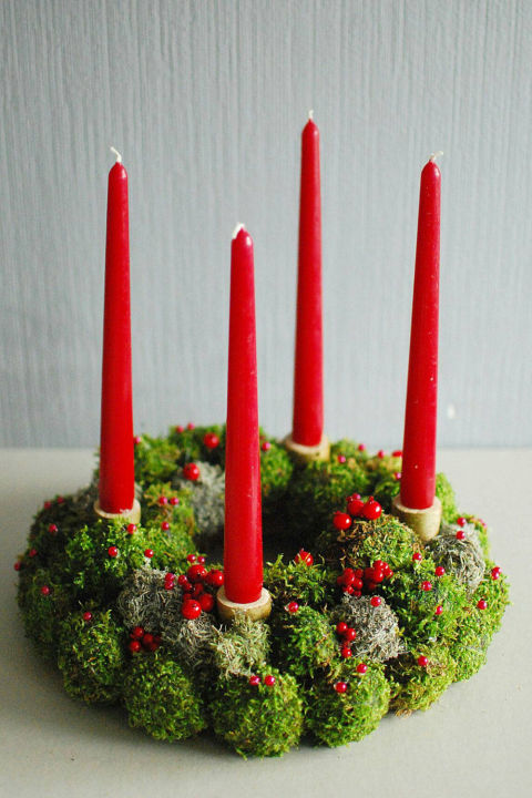 $75 BUY NOW The prettiest wreaths aren't always on the front door. With real dried moss and bright red tapers, this traditionaldecoration doubles as a gorgeous centerpiece.