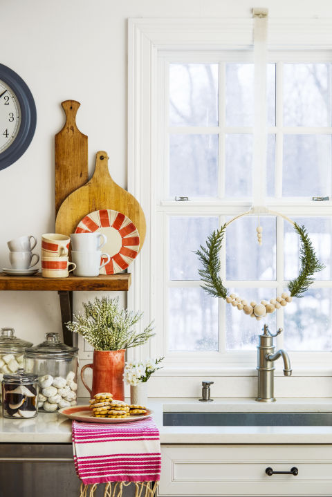 Fancy up your view with a unique wreath made from an embroidery hoop or a garland of lush greenery. What you'll need: embroidery hoop($9,amazon.com), glue gun($11,amazon.com)