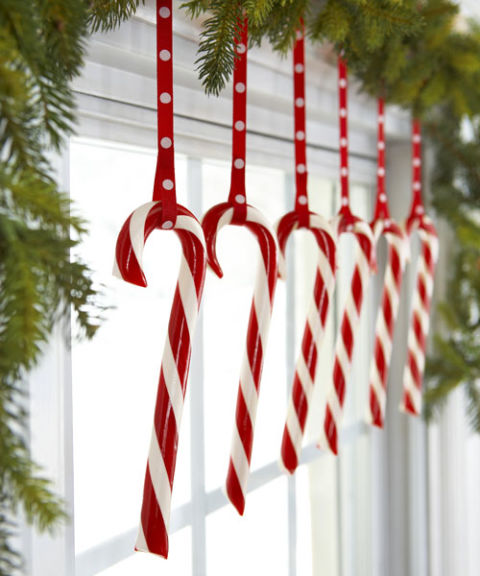 Keep candy canes out of kids' reach but on display by hanging them from a bough-decked window. Hook the peppermints on loops of polka-dot ribbon for added charm. What you'll need: candy canes ($10, amazon.com), garland ($20, amazon.com)
