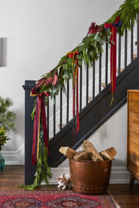 Line a banister with a fresh pine garland and crimson bows. Better yet, stir up some paint in a dramatic hue for a merry makeover you'll love even after the holidays. What you'll need: ribbon ($23, amazon.com)