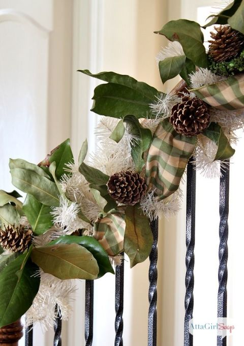 Mix faux garland with real greenery, weaving in pine cones and a matching thick ribbon. This blogger kept hers secure with zip ties. See more at Atta Girl Says » What you'll need: pinecones ($17, amazon.com), magnolia garland ($40, amazon.com)