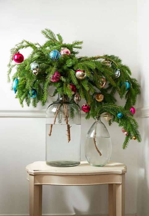 No room for a tree? Decorate an entryway or a tiny apartment with fir, spruce or pine branches in an oversize jar. What you'll need: ornaments ($9, amazon.com), vase ($32, amazon.com)