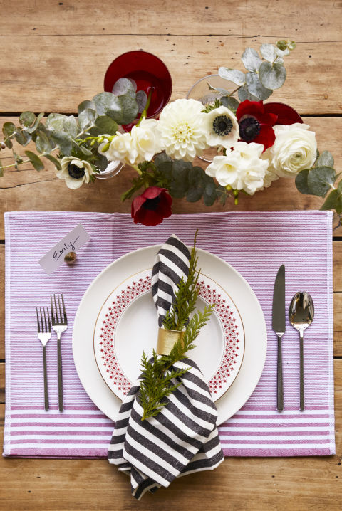 Swap infolded tea towels for placemats and napkins. They work just as well — and they're often cheaper! Colorful tumblers can step in for vases too. What you'll need: tea towels ($16 for 4, williams-sonoma.com), bowl ($63, macys.com), striped towels ($10 for 2, target.com)
