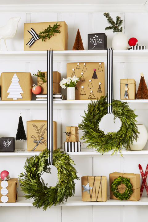 Too many gifts under the tree — or no tree at all? Use a bookshelf! To unify the look, wrap with kraft paper and add black, white and silver accents. What you'll need:kraft paper($18,amazon.com), striped ribbon ($14,amazon.com)