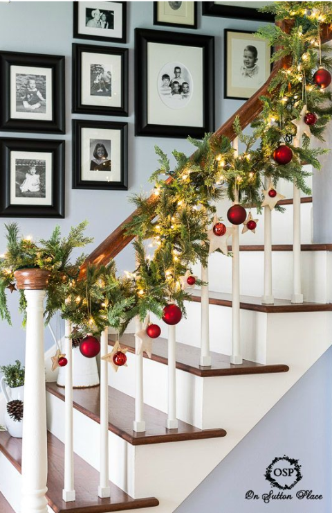 Using different shapes and sizes, add Christmas ornaments to your banister's garland. See more at On Sutton Place » What you'll need:garland($20,amazon.com), ornaments($9,amazon.com)